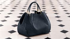 Tod's Women's Autumn Winter 2013-2014 Collection. Indigo leather Signature bag with double handles and link chain detail.