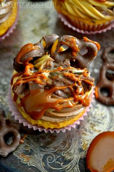 hot fudge ganache, and topped with a swirl of caramel and chocolate ...
