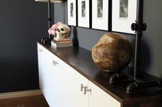 Industrial meets chic styled room by bloggers (and couple) Chris and Julia. Featuring large wooden ball from HomeGoods!