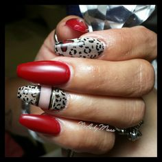 Red and leopard print nails by  @Iamnailzbymari