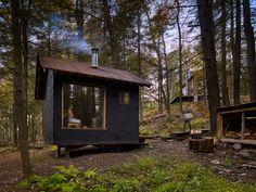 The exterior of the building is clad in shiplap pine, stained black with a traditional Finnish blend of pine tar and linseed oil. A six-feet-square insulated picture window submerses bathers into the woods and glows like a lantern in the dark forest. Sauna House, Sauna Room, Rustic Saunas, Sauna Design, Design Design, Natural Swimming Pools, Natural Pools, Outdoor Sauna, Luxury Pools