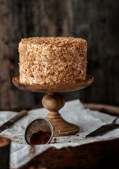 vanilla coconut cake with chocOlate cream and caramelized coconut flakes