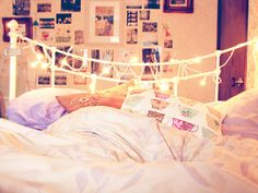From the Making the Bed group on flickr. Love the fairy lights and cozy comforter.