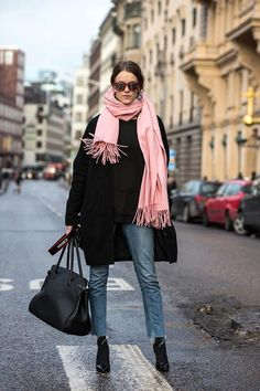 Photos via: Sara Strand I never thought Id consider wearing a bubble gum pink scarf, but Sara...