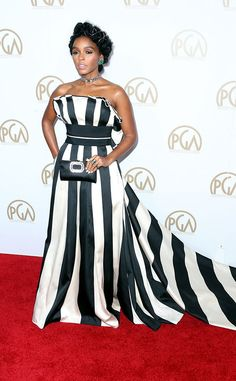Janelle Monae from Producers Guild Awards 2017: Red Carpet Arrivals  TheHidden Figures actress ups the ante at the 2017 PGAs in her bold black and white striped gown.