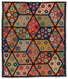 The Diamond Field quilt, American, about 1860. Pieced wool plain weave and twill (some printed), glazed cotton plain weave back, wool plain weave binding; quilted. Pilgrim/Roy Collection.
