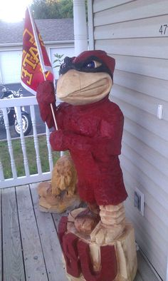 Cy Chainsaw carving. Would like that on my front porch!