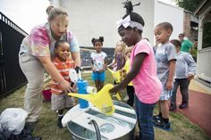 Children plant, water flowers in new YWCA York playground - The York Daily Record