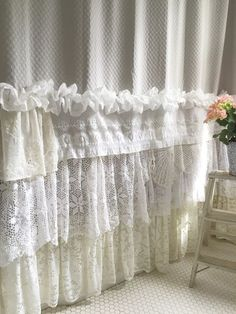 When decorating our homes or buying a special gift for someone, this beautiful soft grey shabby chic shower curtain with its many layers of lace and ruffles is sure to please. Made uniquely for a rare find. Measures 72 inches wide x 87 inches long I hang these on a separate rod than the liner and I place it near the ceiling. If youd like this shorter, one can cut the lace on the bottom.