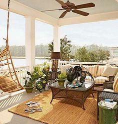 A covered porch off the master bedroom. The interior decorator treated the private space as an open-air sitting room, complete with area rug, table lamps and cozy seating