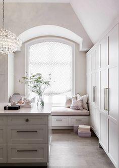 Dressing room with window seat and roman shades. Fabric is by Kravet. #Dressingroom Elizabeth Metcalfe