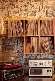 Turntable. Wall shelf. Small Space. The turntable and vinyl collection at local cafe, Fourbarrel - San Francisco.