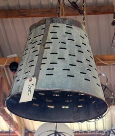 An olive harvesting bucket turned into a pendant light..