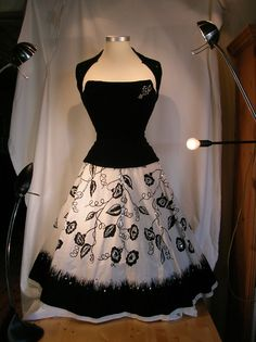 This is a photo of a corset that i made eight years ago and the rather meticulous placing of the various house-lamps to prepare for the shoot of this particular 50's inspired number (we we're rather novices then). However, it show's it all up nicely just as it is.