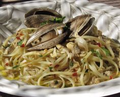 Buttery briny white clam linguini. Exquisite simple earthy pasta laden with garlic and briny clams.   marksdailynosh.com
