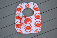 orange crab bib and madras paci clip by YeauxYeauxBows on Etsy, $18.00