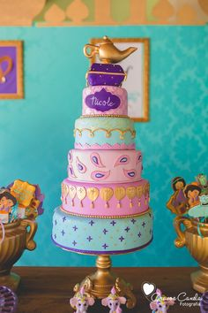 Towering multi-tiered birthday cake from Colorful Princess Jasmine Birthday Party at Kara's Party Ideas. See more at karaspartyideas.com!