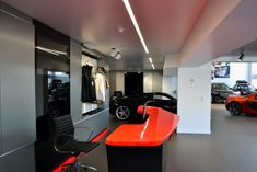 Reception at McLaren Queensland Showroom, Australia. McLaren Gold Coast by Birchall & Partners Architects. Architects with extensive experience designing and building car showrooms since 1988. Architects Ipswich | Architects Brisbane | Architects Gold Coast Brisbane Architects, Southport, Gold Coast, Showroom, Reception, Australia, Building, Car, Home