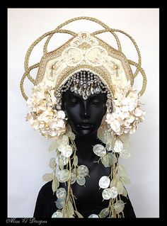 This could be Mother Nature, wearing a lovely headdress.  Empress Headdress by MissGDesignsShop on Etsy, $400.00