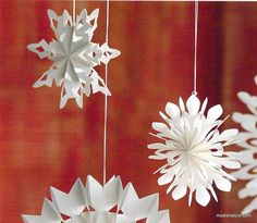 Reminiscent of childhood craft projects, pearlized white paper is folded and cut to create these Roost airy snowflake ornaments. Each set includes 9 snowflakes with 3 different delicate styles. Produc