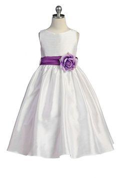 b65a24dd92 Adorable sleeveless flower girl dress with a calf-length skirt in a silk  effect polyester