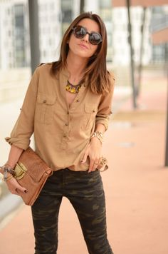 Camo skinny jeans...with a flowy blouse. I'd do a pop of color...
