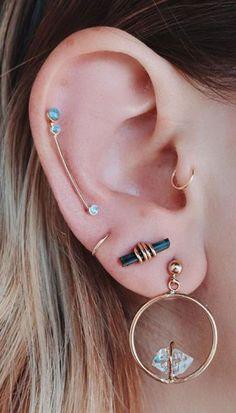 Idée et inspiration Bijoux :   Image   Description   Elegant Multiple Ear Piercing Ideas at MyBodiArt.com – Cartilage Helix