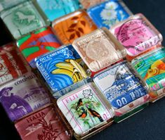 Magnets, set of 10 vintage international postage stamps, by CrowBiz on Etsy.  Where can I get me some heavy square glass tiles???