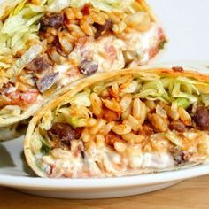 Spicy Bean and Rice Burritos Recipe Main Dishes with canola oil, garlic, chili p. Veggie Recipes, Mexican Food Recipes, Vegetarian Recipes, Dinner Recipes, Cooking Recipes, Healthy Recipes, Mexican Desserts, Freezer Recipes, Freezer Cooking