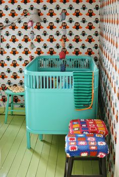 Loving the crazy wallpaper and bright crib/painted floor