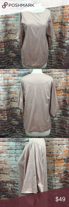 """COS draped sleeve blouse Made from smooth material, this blouse has draped sleeves that has been stitched on inside. An oversized style and fit tapering towards the hemline. Put to pit measures 19"""" inches., length 24"""" inches. COS Tops Blouses"""
