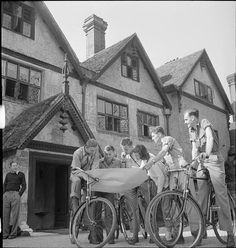 American airmen staying at the Red Cross Rest Home at Stanbridge Earls in Hampshire check the route on a map before setting off for a picnic. With them is a Red Cross hostess at the home.