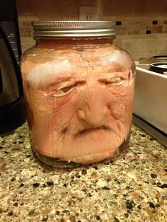 YIKES! Put a costume mask in a jar then add water! Plan on putting a glow stick or submersible LED light in the jar for effect.