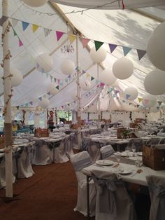 Marquee decorated by family & friends - giant round balloons, handmade bunting, fairy lights and vintage apple crates on the tables for picnic style food.