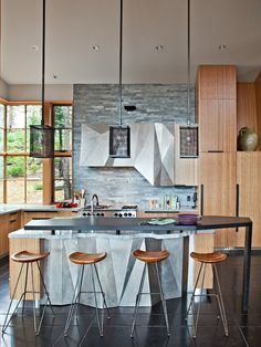 Modern industrial kitchen. Very unique kitchen island.