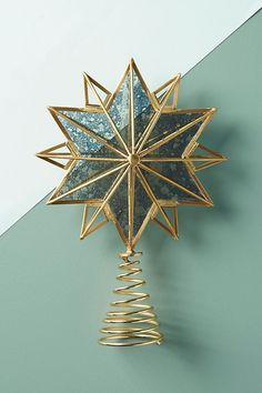 Once you're done hanging the Christmas ornaments, lights, and garland, add the perfect final touch with one of these beautiful tree toppers. Unique Tree Toppers, Diy Tree Topper, Star Tree Topper, Christmas Tree Star Topper, Christmas Star, Christmas Decorations, Holiday Decor, Holiday Ideas, Christmas Heaven