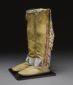 PAIR OF CHEYENNE BEADED AND FRINGED HIDE HIGH-TOP MOCASSINS