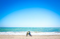 fuengirola, spain, espanja, fisherman, ocean, blue, sea, umbrella, calm, colourful, valokuvaaja porvoo, lilychristina, lilychristina photography