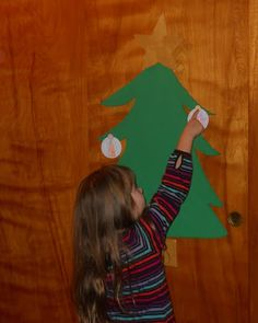 """I was trying to choose between doing a Jesse tree or the Truth in the Tinsel for advent.  Truth in the tinsel won out for me due to the quality of the printables for ease this year due to my work schedule. "" + a cute Christmas tree display from nurturingnateres.blogspot.com"