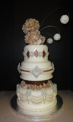 Jeweled Wedding Cake - Fondant covered, gum paste jewels and topper, accented in mahogany and silver pearl dust.