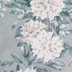 Rhodora Wallpaper A charming wallpaper featuring large scale rhododendron branches arranged in an informal trellis formation. Shown in soft matt teal and white on a subtly metallicised powder blue ground.