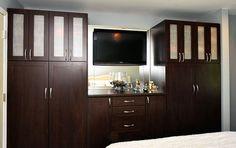 Dark wood California closet in master bedroom