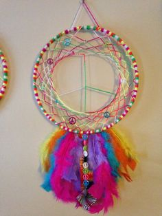 This handmade dreamcatcher is perfect for the hippy at heart. Feather tail with ribbon, bead and jewelry accent. Medicine Wheel, Sun Catcher, Dream Catchers, Mobiles, Peace And Love, Feathers, Wheels, Dreams, Etsy