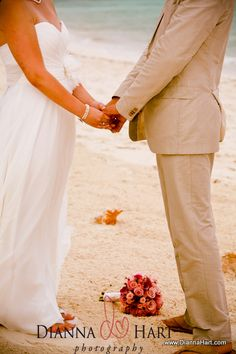holding hands on the beach.  DiannaHart.com