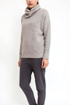 Keep cosy warm this season in this lovely knitted sweater. Featuring a loose turtleneck, ribbed trims and in an understated grey hue, this sweater will prove an effortless go-to for refined, chic ensembles. By Selected Femme.   	Available at Sienna & Lois.