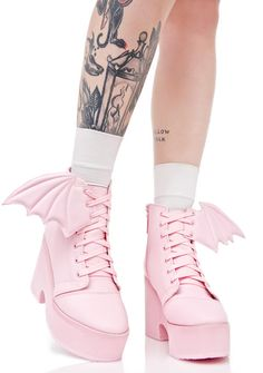 """Iron Fist Bubblegum Bat Wing Boots cuz ya stay fly with yer fellow battie babes. These amazing boots are constructed outta super smooth baby pink vegan leather with epic 3D perforated bat wing details at yer ankles. Featuring interior zippers, front laces, 4"""" heels and 2.5"""" platforms to stomp 'round in."""