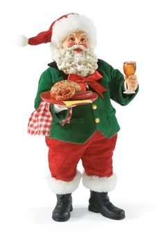 German Santa wishes everyone Guten Appetit! before sitting down to enjoy his plate of German snacks.
