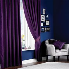 purple curtains and blue walls... Probably would never do this but the colors are awesome together!