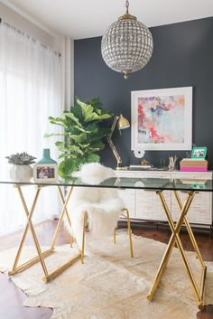 A modern and girly office space with chic furniture and accessories.