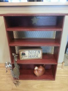 Shelf with chicken wire backing, painted red and distressed